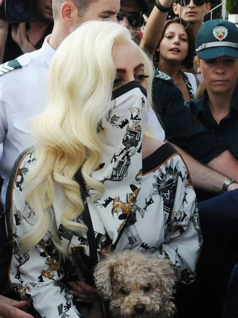 Lady Gaga Covers Face With Mask While Arriving For 'Born